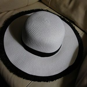 Cute black and white floppy hat.